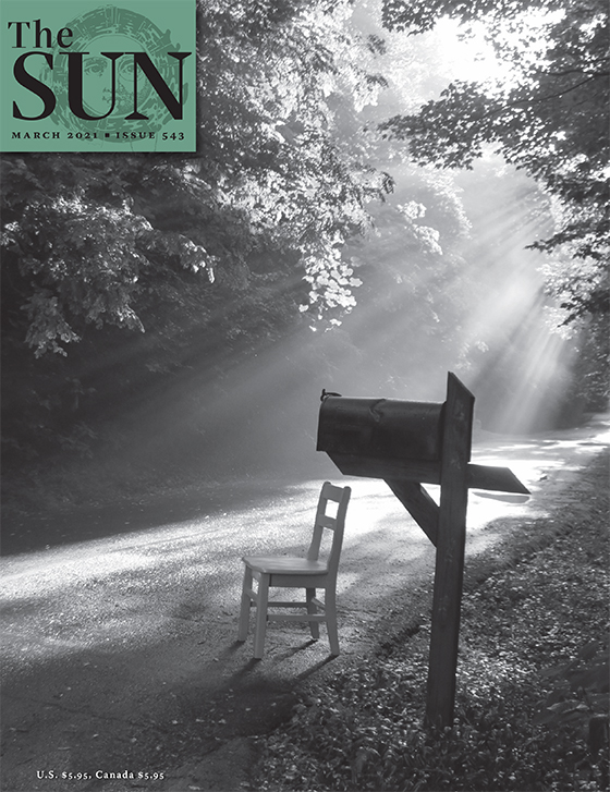 Cover of Issue 543. A wooden chair sits along a path next to a mailbox with a ray of sunlight hitting the chair.