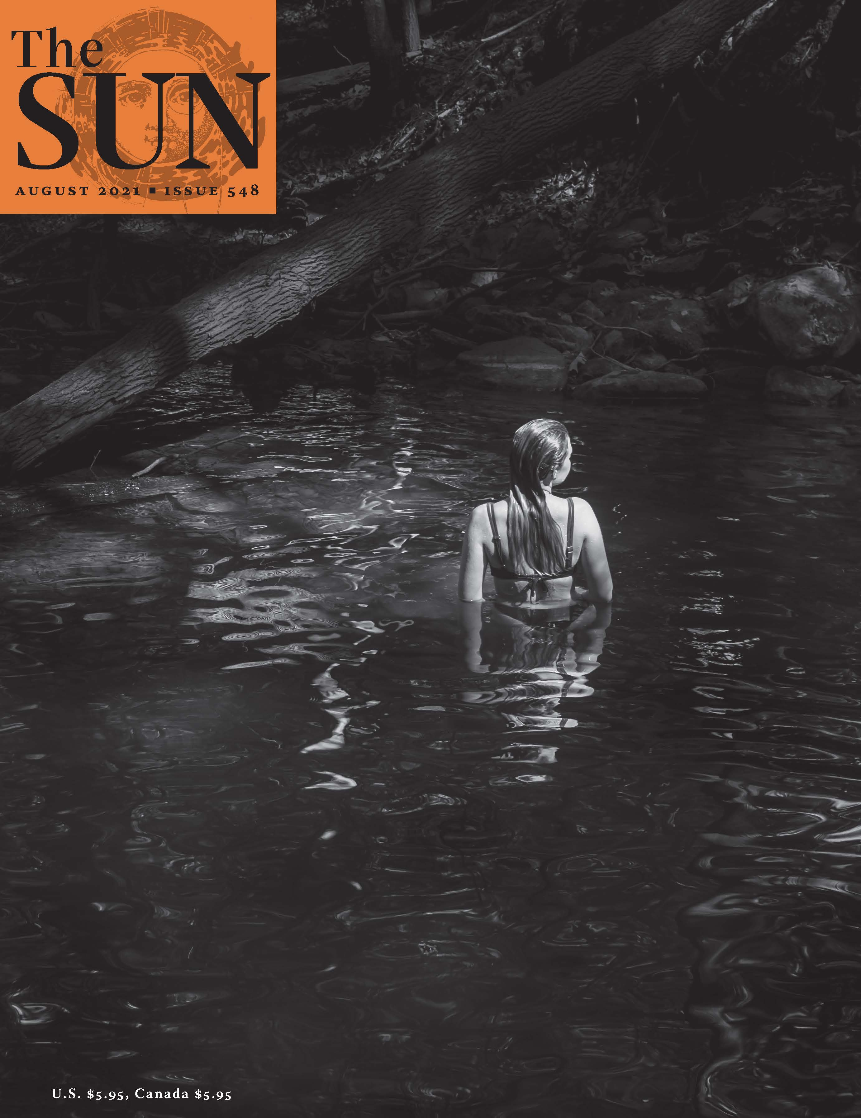 The photographer's daughter in a swimming hole at Slateford Creek Falls in Pennsylvania. The daughter has her back turned to the camera and she's looking slightly to the right.